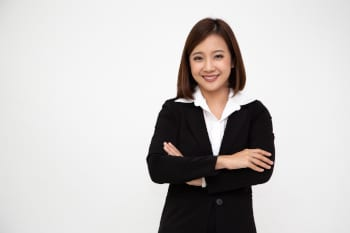Portrait of successful business asian women in black suit with arms crossed and smile isolated over white background, Young businesswoman smiling and looking at camera, Happy feeling concept
