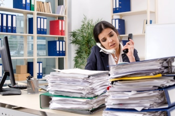 Female employee with too much work in the office