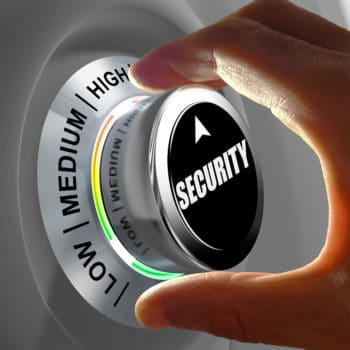 Hand rotating a button and selecting the level of security. This concept illustration is a metaphor for choosing the level of security. Three levels are available: low medium and high.